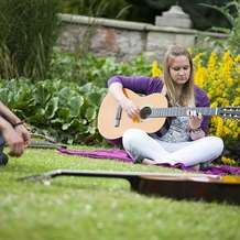 Mindful-guitar-learning-at-health-and-wellness-fair-1532329646